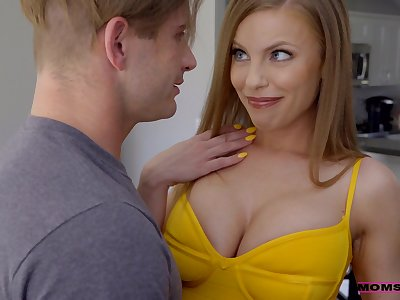 Sexy Britney Amber rides a cock while her big boobs limits up plus down