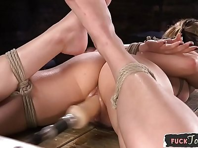 BDSM device babe gets throatfucked