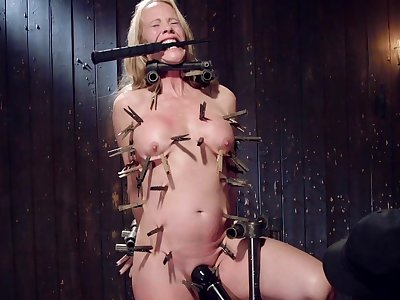 Uncover busty mature hurt and haunted in full clamping BDSM